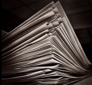 """Stack of Papers"" by Flickr user Jenni C"